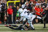 College Park, MD - September 27, 2019: Maryland Terrapins linebacker Ayinde Eley (16) tackles Penn State Nittany Lions running back Ricky Slade (3) during game between Penn St and Maryland at  Capital One Field at Maryland Stadium in College Park, MD.  (Photo by Elliott Brown/Media Images International)