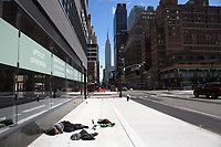 NEW YORK, NY - MARCH 24: A man sleeps on the street with the Empire State Building in the background on March 24, 2020 in New York City. New York City, with more than 25,000 confirmed cases of (COVID-19), makes it the epicenter of the outbreak in the United States. (Photo by Pablo Monsalve / VIEWpress via Getty Images)