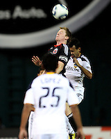Dax McCarty (10) of D.C. United beats Juninho (19) of the Los Angeles Galaxy to a header during an MLS match at RFK Stadium, on April 9 2011, in Washington D.C.The game ended in a 1-1 tie.