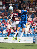 Ryan Camplin of Colchester United beats Nicky Adams of Northampton Town to the header during Colchester United vs Northampton Town, Sky Bet EFL League 2 Football at the JobServe Community Stadium on 24th August 2019