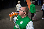 A Hibernian fan drinking a bottle of Irn Bru outside Meadowbank Stadium before the Scottish Cup winners took on hosts Edinburgh City in a pre-season friendly. The match was City's first at the Commonwealth Stadium since they gained promotion from the Lowland League to the Scottish League in May 2016. A record crowd for a City match of 2500 spectators saw the visitors run out 6-1 winners.