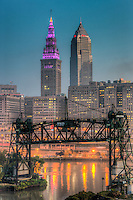 The Terminal Tower and Key Tower dominate the skyline of Cleveland, Ohio during morning twilight just prior to sunrise.  The Terminal Tower lights are purple in support of Domestic Violence Awareness.  The Terminal Tower was the 4th tallest building in the world when built in 1930 and remained the tallest in Cleveland until the completion of the Key Tower (then Society Tower) in 1991.  This view includes the abandoned Eagle Avenue Bridge, a vertical-lift bridge spanning the Cuyahoga River.
