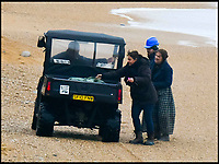 BNPS.co.uk (01202 558833)<br /> Pic: Graham Hunt/BNPS<br /> <br /> Kate Winslet is driven down to the dangerous cliffs at Charmouth to film this afternoon.<br /> <br /> Film crew and actors on the Beach at Charmouth in Dorset today for the filming of the new film Ammonite about the life of fossil hunter Mary Anning starring Kate Winslet and Saoirse Ronan.<br /> <br /> Kate Winslet taking a ride in an off road buggy to her next filming location.