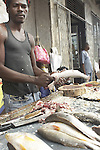 Fishmonger working in the central market of Paramaribo, Suriname.
