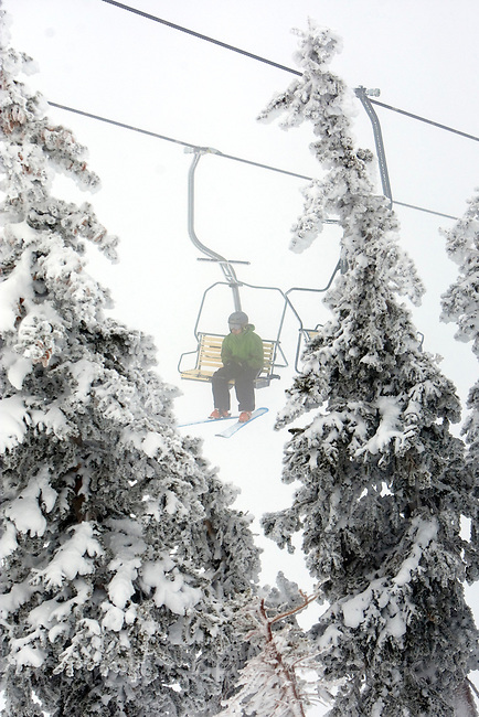 Photo by Chris Detrick  |  The Salt Lake Tribune .A skier rides the Little Cloud lift at Snowbird Saturday January 2, 2010.