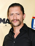 "HOLLYWOOD, CA. - August 24: Clifton Collins, Jr.  arrives at the Los Angeles premiere of ""Extract"" at the ArcLight Hollywood on August 24, 2009 in Hollywood, California."