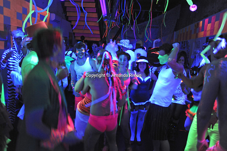 Revelers are seen on the dance floor at the Black and Light Ball on the Bowery in Lower Manhattan in New York, New York on May 9, 2009.