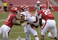 NWA Democrat-Gazette/ANDY SHUPE<br /> Arkansas receiver Koilan Jackson (3) is tackled Saturday, April 6, 2019, by defensive backs Kamren Curl (from left), Jarques McClellion and linebacker Deon Edwards during the Razorbacks' spring game in Razorback Stadium in Fayetteville. Visit nwadg.com/photos to see more photographs from the game.