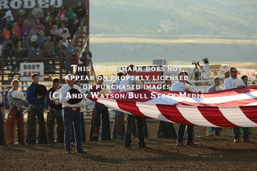 Opening, Flag, Cody WY PRCA X-Bulls. Photo by Andy Watson. All Photos (C) Watson Rodeo Photos, INC. Must have written Permission for any use.