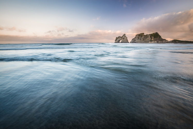 Archway islands and surf - Wharariki Beach New Zealand - stock photo, canvas, fine art print