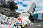 A recycling truck unloads at a station at Northwest Recycling in Bellingham, Wash. Bellingham is one of only a handful of cities in Washington state without single-stream recycling, so residents must sort their recyclable items into three separate bins. Photo by Daniel Berman