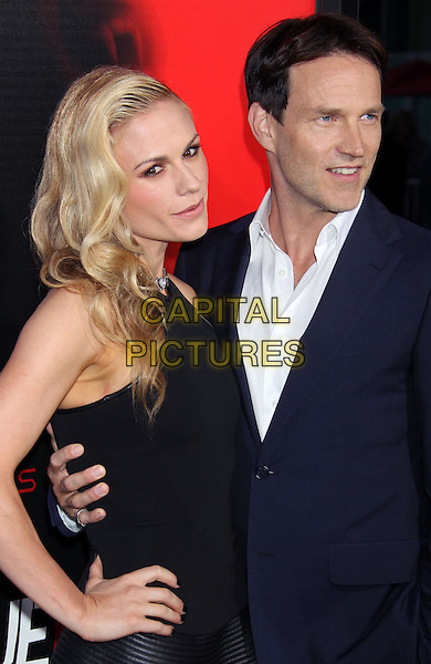 Anna Paquin &amp; Stephen Moyer<br /> &quot;True Blood&quot; Season 6 Los Angeles Premiere held at The Cinerama Dome, Hollywood, California, USA.<br /> June 11th, 2013<br /> half length top dress hand on hip black sleeveless blue suit white dress married husband wife <br /> CAP/ADM/RE<br /> &copy;Russ Elliot/AdMedia/Capital Pictures