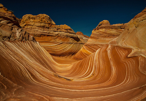 Bright colors and swirling lines formed by erosion in the Navajo Sandstone has produced The Wave at Coyote Buttes on the Utah, Arizona border.