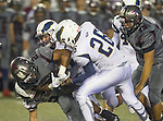 Torrance, CA 09/25/15 - Jeremiah Aiono (Torrance #28), Billy Brasher (El Segundo #24), Peter Amara (El Segundo #26) and unidentified El Segundo player(s) in action during the El Segundo - Torrance varsity football game at Zamperini Field of Torrance High School