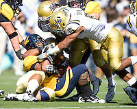 Isi Sofele of California gets tackled by UCLA defenders during the game at Memorial Stadium in Berkeley, California on October 9th, 2010.   California defeated UCLA, 35-7.