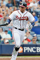 Atlanta Braves first baseman Freddie Freeman #5 takes first after being walked during a game against the Colorado Rockies at Turner Field on September 3, 2012 in Atlanta, Georgia. The Braves  defeated the Rockies 6-1. (Tony Farlow/Four Seam Images).