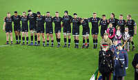 Ospreys players observe a minute's silence with other players and officials before kick off during the Anglo-Welsh Cup match between Ospreys and Wasps at The Liberty Stadium, Swansea, Wales, UK. Friday 10 November 2017