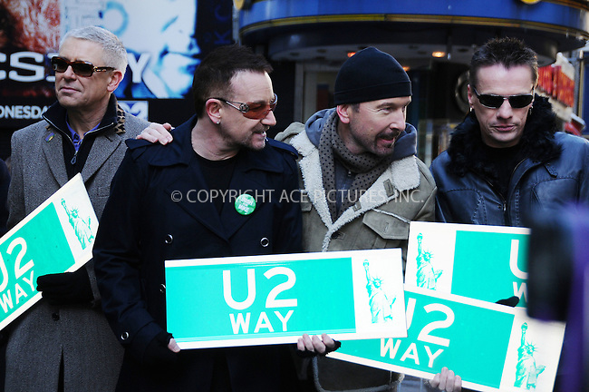 WWW.ACEPIXS.COM . . . . .  ....March 3 2009, New York City....Irish band U2 (L-R Adam Clayton, Bono, The Edge, Larry Mullen Jr.) attend the temporary re-naming of a section of 53rd Street 'U2 Way' in Manhattan on March 3 3009 in New York City.....Please byline: AJ Sokalner - ACEPIXS.COM..... *** ***..Ace Pictures, Inc:  ..tel: (212) 243 8787..e-mail: info@acepixs.com..web: http://www.acepixs.com