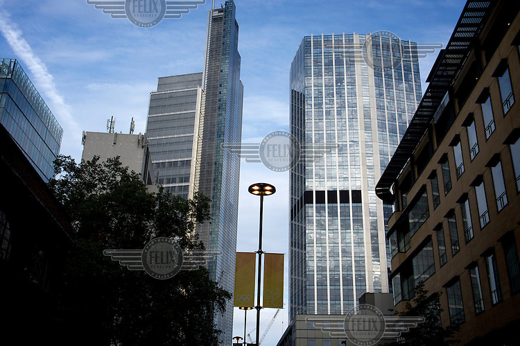 Heron Tower (left), 110 Bishopsgate, City of London. Heron tower was, in 2012, London's second tallest building, rising 242 metres over 46 floors. It was completed in 2011and the architects were Kohn Pedersen Fox Associates. 99 Bishopsgate (right) a 103.6 metre tower finished in 1976.