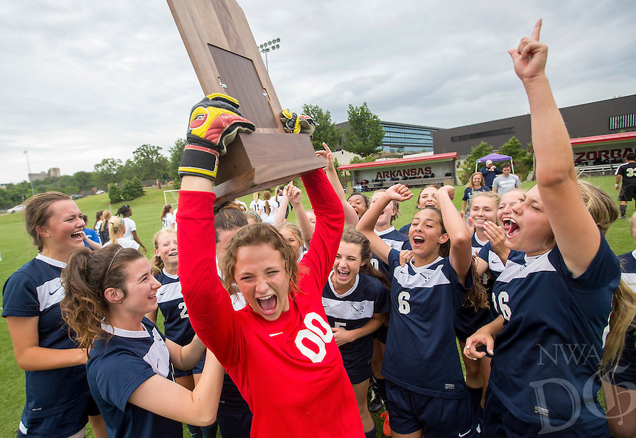 NWA Democrat-Gazette/JASON IVESTER --05/22/2015--<br /> Little Rock Christian keeper Olivia Allen hoists the trophy with teammates following their 2-1 win over Pulaski Academy in the 5A championship game on Friday, May 22, 2015, at Razorback Field in Fayetteville.