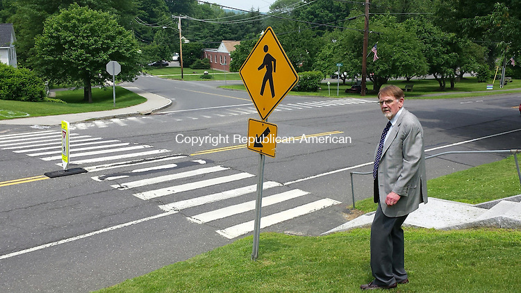 WOODBURY, CT:11 June 2015:061115BB01 --- First Selectman William J. Butterly Jr. stands by a crosswalk he wants to move 150 feet to the south, so pedestrians can cross Main Street more safely. Bill Bittar Republican-American
