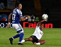 BOGOTÁ-COLOMBIA, 15–02-2020: Ayron del Valle de Millonarios y Nelino Tapia de Chicó F.C. disputan el balón, durante partido entre Millonarios y Boyacá Chicó F.C. de la fecha 5 por la Liga BetPlay DIMAYOR 2020 jugado en el estadio Nemesio Camacho El Campín de la ciudad de Bogotá. / Ayron del Valle of Millonarios and Nelino Tapia of Boyaca Chico F.C. figth for the ball, during a match between Millonarios and Boyaca Chico F.C. of the 5th date for the BetPlay DIMAYOR Leguaje I 2020 played at the Nemesio Camacho El Campin Stadium in Bogota city. / Photo: VizzorImage / Luis Ramírez / Staff.