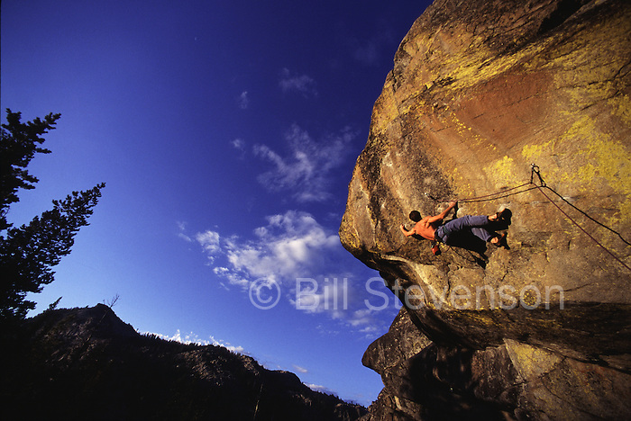 A picture of a man rock climbing on Donner Summit in California.