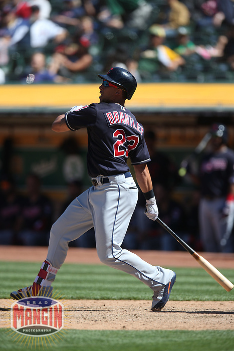 OAKLAND, CA - JUNE 30:  Michael Brantley #23 of the Cleveland Indians bats against the Oakland Athletics during the game at the Oakland Coliseum on Saturday, June 30, 2018 in Oakland, California. (Photo by Brad Mangin)