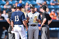 Asheville Tourists manager Warren Schaeffer (13) with Columbia Fireflies manager Jose Leger (19), home plate umpire Tyler Jones and first base umpire Anthony Perez before a game against the Columbia Fireflies at McCormick Field on June 18, 2016 in Asheville, North Carolina. The Tourists defeated the Fireflies 5-4. (Tony Farlow/Four Seam Images)