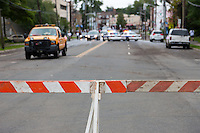 MAMARONECK, NY - AUGUST 28: Village police cruisers and barricades limit vehicular access to flooded Mamaroneck Avenue in the Village of Mamaroneck, New York on Sunday August 28, 2011 in the aftermath of Hurricane Irene.