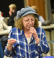 NWA Democrat-Gazette/FLIP PUTTHOFF <br /> AROMATIC OILS<br /> Laurie Allen of Avoca sniffs a sample of fragrant oil on Tuesday March 12 2019 during a presentation on essential oils at the Rogers Public Library. Kristin Jones with the library staff gave the program on various oils and their uses, including lavender, francincense and lemon oil. The program was featured at the library's monthly Lunch and Learn gathering. Lunch and Learn takes place the second Tuesday of each month from noon to 1 p.m. Friends of the Rogers Public Library sponsor Lunch and Learn.