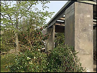 BNPS.co.uk (01202 558833)<br /> Pic: UniqueHomeStays/BNPS<br /> <br /> Before the transformation.<br /> <br /> Bomb proof hideaway - the perfect place to cement a relationship...<br /> <br /> A concrete carport has been transformed into a ultra cool luxury staycation bolt hole - with even its fireplace, kitchen worktops and bath made from concrete. <br /> <br /> The Hide is perfect for romantic weekends away or creative solo escapes but it will set the minimalist traveller back up to &pound;2,350 a week in peak season.<br /> <br /> Despite its slightly industrial appearance, it is actually a cosy rural retreat, surrounded by nature at the end of a winding country lane three miles from Perranporth beach in north Cornwall.<br /> <br /> Unique Home Stays used a bird hide as the inspiration with quirky stick-out windows that allow guests to stargaze from the bed and lighting designed to replicate the effect of sunlight through trees.