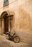 Moped parked outside building, Sospel, France
