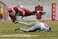 NWA Media/Michael Woods --11/22/2014-- w @NWAMICHAELW...University of Arkansas tight end AJ Derby is tripped up by Ole Miss defender Tony conner in the first quarter of Saturdays game at Razorback Stadium.