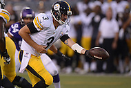 Canton, Ohio - August 9, 2015: Landry Jones #3 of the Pittsburgh Steelers moves to hand off to Cameron Stingily #30 during a preseason game against the Minnesota Vikings at the Hall of Fame Stadium in Canton, Ohio, August 9, 2015.  (Photo by Don Baxter/Media Images International)