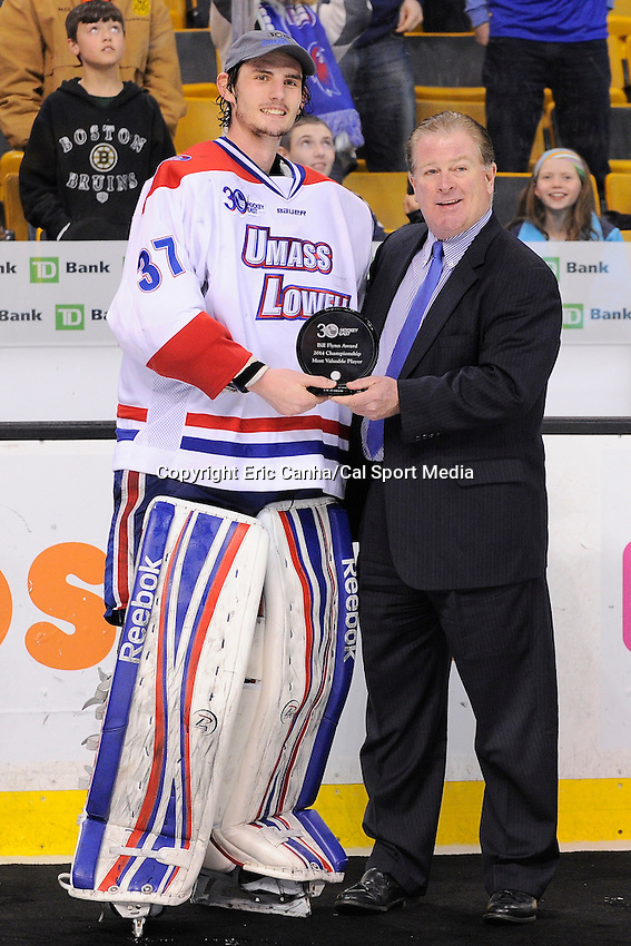 March 22, 2014 - Boston, Massachusetts , U.S. - UMass Lowell's Connor Hellebuyck (37) receives the tournament MVP trophy at the NCAA Hockey East tournament championship game between the University of Massachusetts  and the University of New Hampshire at TD Garden in Boston Massachusetts.  UMass defeated UNH 4-0. Eric Canha/CSM