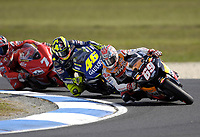 Nicky Hayden (USA), Valentino Rossi (ITA) and Carlos Checa (SPN) round the corner.<br /> Motorcycles - MotoGP Phillip Island/ Round 15<br /> 2005 Australian Motorcycle Grand Prix<br /> Phillip Island, Victoria, Australia. Oct. 16, 2005<br /> &copy; Sport the library/Courtney Harris