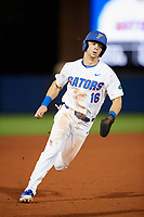 Florida Gators right fielder Wil Dalton (16) running the bases during a game against the Siena Saints on February 16, 2018 at Alfred A. McKethan Stadium in Gainesville, Florida.  Florida defeated Siena 7-1.  (Mike Janes/Four Seam Images)