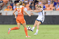 Houston, TX - Saturday July 08, 2017: Lindsey Horan passes the ball during a regular season National Women's Soccer League (NWSL) match between the Houston Dash and the Portland Thorns FC at BBVA Compass Stadium.