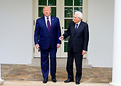 President Sergio Mattarella of the Italian Republic, right, appears to be offering to shake the hand of United States President Donald J. Trump, left, as they pose for a photo while standing on the Colonnade of the White House in Washington, DC on Wednesday, October 16, 2019.<br /> Credit: Ron Sachs / CNP