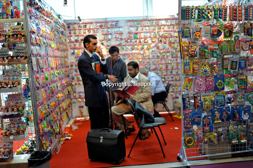 Businessmen at a toy stall at the world's largest trade fair, China Import and Export Fair (Canton Fair) in Guangzhou, China. The trade fair which last the month of April draws to gather manufacturers from across China and attracts businessmen from around the world..26 Apr 2009