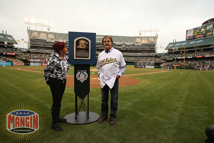 OAKLAND, CA - AUGUST 9:   Hall of Fame Manager Tony La Russa and his wife Elaine stand with his Hall of Fame plaque prior to the start of a Major League Baseball game between the Oakland Athletics and Minnesota Twins at O.co Coliseum on August 9, 2014 in Oakland, California. Photo by Brad Mangin