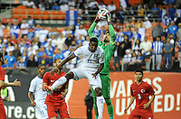 Washington, D.C.- May 29, 2014. Turkey goalkeeper Tolga Zengin goes up to make a save against Honduras forward Jerry Bengston.  Turkey defeated Honduras 2-0 during an international friendly game at RFK Stadium.