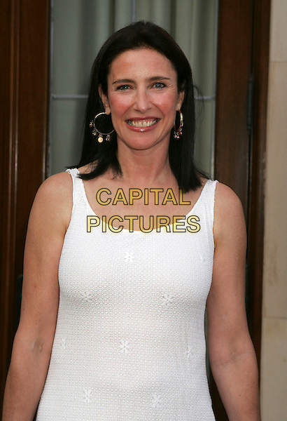 MIMI ROGERS.Chrysalis's 5th Annual Butterfly Ball held at the Italian Villa of Carla and Fred Sands, Bel Air, California, USA..June 10th, 2006.Photo: Russ Elliot/AdMedia/Capital Pictures.Ref: RE/ADM.half length white tank top.www.capitalpictures.com.sales@capitalpictures.com.© Capital Pictures.
