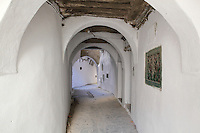 A typical covered narrow street with overhead archways in the medina or old town of Tetouan, on the slopes of Jbel Dersa in the Rif Mountains of Northern Morocco. Tetouan was of particular importance in the Islamic period from the 8th century, when it served as the main point of contact between Morocco and Andalusia. After the Reconquest, the town was rebuilt by Andalusian refugees who had been expelled by the Spanish. The medina of Tetouan dates to the 16th century and was declared a UNESCO World Heritage Site in 1997. Picture by Manuel Cohen