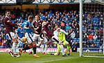 22.04.2018 Rangers v Hearts: Steven Naismith hooks the ball away as Jason Cummings is pulled back