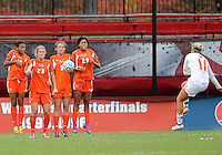 COLLEGE PARK, MD - OCTOBER 28, 2012:  Olivia Wagner (11) of the University of Maryland blasts a free kick at Jasmine Paterson (15), Ali Brennan (23), Ashley Flinn (5) and Blake Stockton (29) of Miami during an ACC  women's tournament 1st. round match at Ludwig Field in College Park, MD. on October 28. Maryland won 2-1 on a golden goal in extra time.