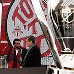 08 December 2016: Toronto mayor John Tory (right) talks with Canadian soccer legend Dwayne De Rosario (left) before the press conference. Major League Soccer's Philip F. Anschutz Trophy made an appearance with Toronto's mayor at a press conference outside of BMO Field in Toronto, Ontario in Canada two days before MLS Cup 2016.