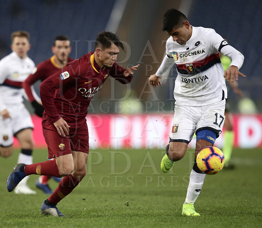 Football, Serie A: AS Roma - Genoa, Olympic stadium, Rome, December 16, 2018. <br /> Genoa's Cristiano Romero (r) in action with Roma's Cengiz Under (l) during the Italian Serie A football match between Roma and Genoa at Rome's Olympic stadium, on December 16, 2018.<br /> UPDATE IMAGES PRESS/Isabella Bonotto
