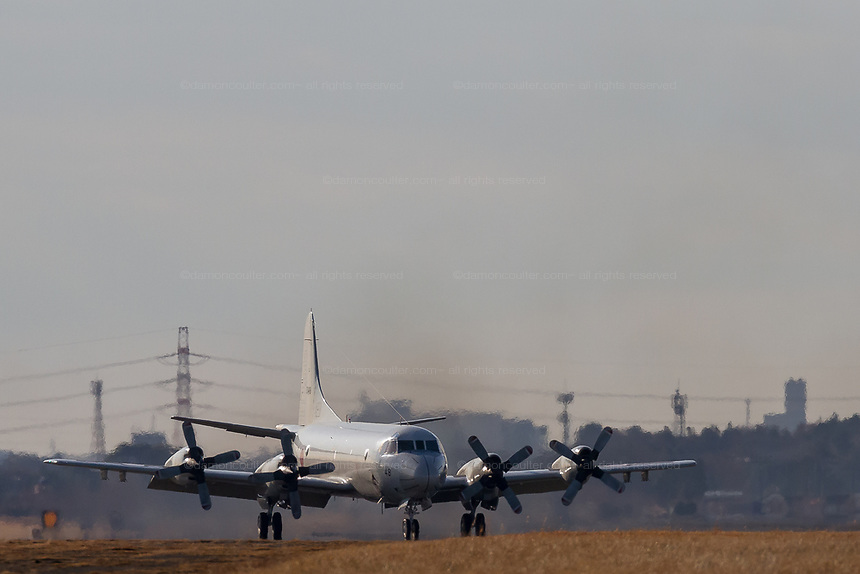 A Lockheed P-3C Orion Maritime reconnaissance aircraft with the Japanese Maritime Self Defence Force taxis after landing at ,Naval Air Facility, Atsugi, Yamato, Kanagawa, Japan. Wednesday January 16th 2019